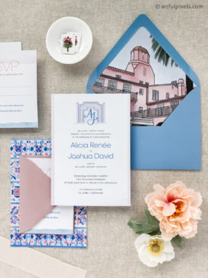Custom wedding invitations with watercolor illustrations of the venue